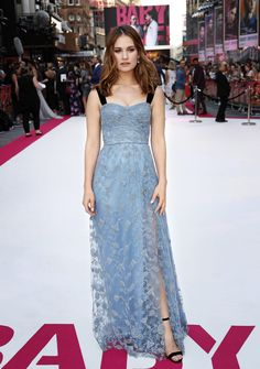 British actress Lily James wears a Burberry blue embroidered lace gown with black velvet straps at the premiere of 'Baby Driver' in London