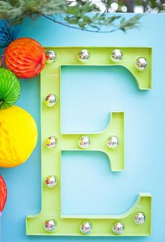 DIY Marquee Letter - using a 24″ paper mache letter from a local craft store