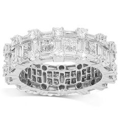 This glamorous womens eternity band is handcrafted in lustrous 18K white gold. The frame is detailed with brilliant round, princess and emerald cut diamonds which total to 4.18 carats. The frame measures to 1/4 inches in width and weighs 6.3 grams. Gleaming in absolute beauty, this ring is an ideal gift for that special someone. $5,338.00