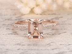 Ring Information----   Main Stone : * Natural Pink Morganite * 7×9mm Emerald Cut Side Stone: * Natural South African Diamond * SI Clarity, H