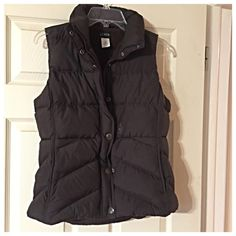 Brown puffy vest in excellent used condition Cozy & comfy! This puffy vest is lined with fleece & will keep you warm. Snap closure, two pockets, & no signs of wear J. Crew Jackets & Coats Vests