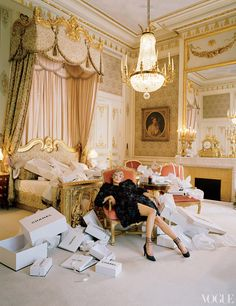Karl Lagerfeld took over the first-floor-spanning Imperial Suite, seen here, for his 1996 couture collection. Chanel Haute Couture embroidered organza flower coat and pumps.