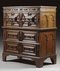 A LARGE CHEST OF DRAWERS, DUTCH, LATE 17TH CENTURY oak and ebonised, with three long drawers, the sides with arched panels, now on bracket feet