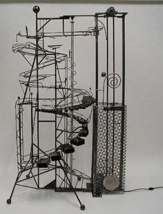 """""""California Dreamin """" (81x50x32) is a motorized kinetic art ball machine sculpture with 2 steel balls that get lifted by a drive chain conve..."""