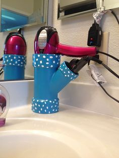 Just paint a PVC connector piece to match your bathroom and have a handy holder for your blowdryer and curling iron. No more worrying about burning something!