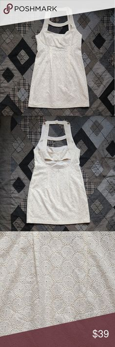 "Nanette Lepore Summery Sleeveless Floral Eyelet So gorgeous, wish I had found it in my size! Needs some oversized sunglasses, a floppy hat, bare feet, and a tall cocktail on the rocks! Warmer than pure white. Tag in the back is partially detached. Beautiful, beautiful shape. Gently worn, if at all.  9"" across the shoulders. 17.5"" across the bust. 16.75"" across the waist. 20"" across the hips. 23"" across the hem. 37"" top to bottom.  Pepper me with questions, I can take it! 🌟 Nanette Lepore…"