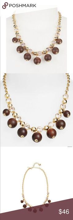 """🎉SALE🎉Kate Spade second nature wood necklace This gorgeous necklace by Kate Spade has earthy wood beads with clear crystal accents . It's approx 17"""" with a 2 3/4"""" extender . 12k gold plating , wood and glass. (I also have one with pale pink stones ) kate spade Jewelry Necklaces"""