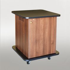 SCMR-17 Mobile Monitor Rack Cabinet in Walnut Melamine - Front View. There is full rear access through a locking panel and the cabinet has a locking pocket door. #Infocomm2012