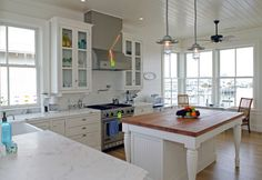 Maple butcher block island + Marble counters