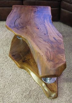 live edge California shaped coffee table - natural edge wood slabs in all shapes and sizes can be found at http://www.BerkshireProducts.com