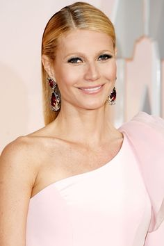 Hairstylist Blake Erik pinned back Gwyneth Paltrow's sleek hair on either side, let the top fall over it and finished with a healthy misting of high-shine hairspray.   - HarpersBAZAAR.com