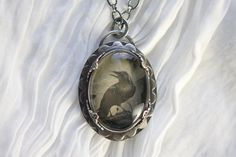 Collodion Image shot in camera on Quartz Crystal in silversmithed sterling silver setting. The Collodion image was taken of an antique Raven illustration. by: Angie Pember Brockey