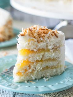 Moist coconut filled layers of cake are stuffed with a sweet and tangy lemon curd, then coated with a light and fluffy coconut buttercream frosting and topped with a delightful pile of toasted coconut. Lemon Layer Cakes, Layer Cake Recipes, Cupcakes, Cupcake Cakes, Cake Cookies, Just Desserts, Dessert Recipes, Cake Ingredients, Cake Batter