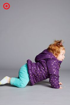 The girl who's going places will want a pretty jacket in a color and pattern that pops. Bundle up your baby in the Cherokee purple hooded puffer jacket, and she'll keep warm and look super cute even as the temperature drops.
