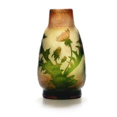 A Daum cameo glass vase circa 1900 colourless glass with an opalescent layer, overlaid in bright green and pink, etched with dandelions on a martelé ground, partly firepolished engraved Daum Nancy with Lorraine cross height 25,5 cm