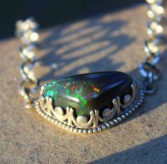 Arco iris Negro Opal, Opal colgante, plata, Negro Opal, joyas de piedras preciosas, metafísicos, collar de ópalo, ópalo áspero, crudo Opal de SagesLeaf en Etsy https://www.etsy.com/es/listing/468777285/arco-iris-negro-opal-opal-colgante-plata