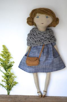 This one-of-a-kind doll is handcrafted using natural and sustainable materials of the highest quality. She is constructed from tea stained cotton & linen cloth and 100% wool stuffing. Her cheeks are tinted with natural dyes and her hair is sewn by hand using alpaca fiber. Her features are hand-embroidered with linen thread and button-jointed with wooden buttons made locally from renewable resources. Each doll comes with a hand crocheted shawl made from natural fibers with an antique ...