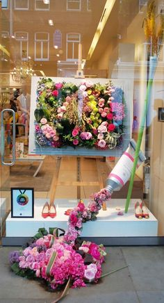 The beautiful piece of floral art grabs your eye at LK Bennett as the over sized paint tube & brush lead your eyes down to the product (colorful shoes). On the other side, if your eyes are down as you walk by, the flower paint spilled on the sidewalk will lead your eye into the window in the reverse direction. (Image source: VM)