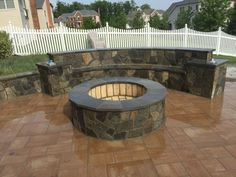 A beautiful Paver Patio with Seating Walls and a Fire Pit.