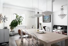 Dining area of jugend house apartment. Interisting combination of contemporary and eclectic styles of interior design. The apartment is listed for sale at Bo LKV.