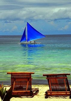 A blue sailed banca passing by a serene beach off in Bora Bora, Tahiti Bora Bora, Tahiti, Voyage Philippines, Boracay Philippines, Philippines Travel, Philippines Beaches, Oh The Places You'll Go, Places To Travel, Places To Visit