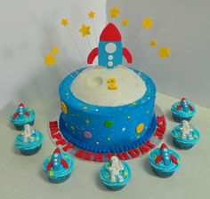 Rocket Ship and moon themed boys birthday cake with matching cupcakes. Design was brought in by client, by unknown cake artist.