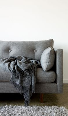 Cuddle up on this modern yet comfy sofa