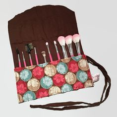 Unique make-up brush holder that holds 10 brushes and rolls up and ties for easy storage and travel. Washing machine safe on gentle cycle cold and