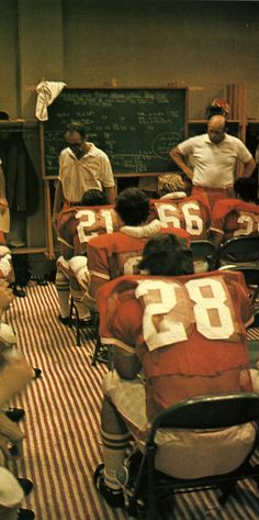 Head football coach Lou Holtz in the locker room. (1973)