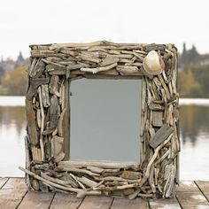 Bring a bit of the beach home with this organic driftwood framed mirror. Sized at 24 inches square, it's the perfect finishing touch to any coastal room.  Each one of these is custom hand crafted jus