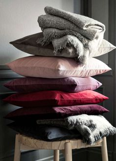 h and m stack of velvet cushions in blush pink purple burgundy and plum