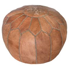Handmade tan leather pouf with a medallion design. Product: Pouf Construction Material: Genuine leather and foam fill Color: Dark tan Features: Handmade in Morocco Dimensions: H x Diameter Leather Pouf Ottoman, Moroccan Leather Pouf, Moroccan Pouf, Leather Pillow, Moroccan Decor, Moroccan Style, Moroccan Lounge, Moroccan Furniture, Ottoman Footstool