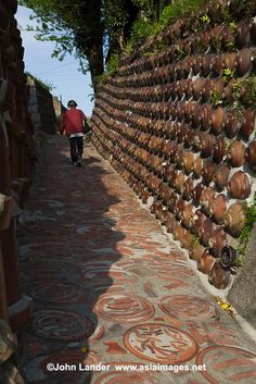"""Tokoname pottery town's famous """"Pottery Walk"""" passes by kilns, potters, shops and ceramics embedded into the sidewalk and walls making for a colorful stroll through one of Japan's most famous centers of ceramics.  #aichi #apan"""