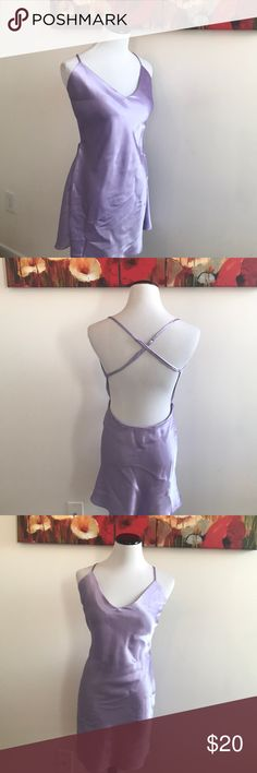 Lilac Victoria's Secret Sexy back nightie Stunning lilac nightie from Victoria's Secret. Back straps are adjustable. Really beautiful condition. No stains. Color and vibrancy closet to first picture Victoria's Secret Intimates & Sleepwear Chemises & Slips
