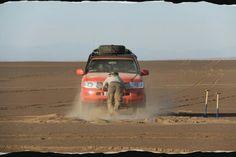 Henry Cavill and Neil Hodgson drive across Taklamakan Desert in China.
