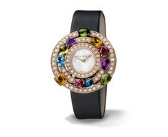 Bulgari ASTRALE WATCH  Quartz movement. 36 mm 18-ct pink gold curved case set with brilliant-cut diamonds and fancy-cut coloured gemstones. White mother-of-pearl dial. Black satin strap with 18-ct pink gold folding clasp. Ref. 102011 AEP36D2CWL