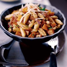 "Cavatelli with Spicy Winter Squash | ""This pasta,"" Mario Batali says, ""always propels me into fall."" You can substitute pumpkin or hubbard squash—whichever looks more beautiful at your market—for the butternut. ""Cook the squash until it's soft but not falling apart—you don't want al dente squash, but you don't want mush either,"" Batali says."