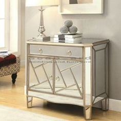 Open up this beautiful Geometrical Mirrored Accent Cabinet to reveal ample storage space for electronics, blankets, or other accessories.