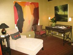Bold wall with even bolder paintings really brings life to your office!