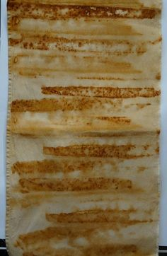 I have been rust dyeing for over a decade and I now run rust dyeing workshops. In the course of my creating and teaching I often accumulate scraps left over from my stitch and samples which Im now selling as small taster packs or individual pieces. This piece of cloth was dyed using old carpentry files. It has a nice weight to it and is taken from a vintage sheet and has one of the hems down one side. The cloth has been photographed, both front and back, indoors so colours may vary…