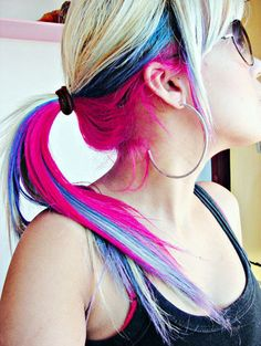 Crazy Hair Colors are in here in the US as well (my hair is bright red right now), especially as peekaboo style like this, so the top is classy and the bottom is crazy :)