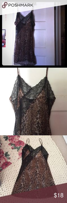 Frederick's of Hollywood Sheer Leopard/Lace Slip Sexy nylon leopard print slip featuring black lace bias cut down the side and on the décolletage. Spaghetti straps that are adjustable with slight stretch to the slip. Sheer, alluring, and perfect for a romantic night with your sweetheart. 18 inches across bust lying flat and approximately 35 inches in length shoulder strap to hem. Never worn; too tight post pregnancy. ☹️ Get it while you can! Frederick's of Hollywood Intimates & Sleepwear…