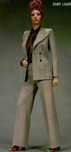 1971 - Yves Saint Laurent the iconic 70s pantsuit in tan jacket pants wide leg vintage fashion style photo print ad designer model magazine