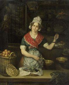 Henriëtta Christina Temminck | Fruit Seller, Henriëtta Christina Temminck, 1840 - 1860 | De fruitverkoopster. Een jonge vrouw staat achter de toonbank van een winkel en weegt met een weegschaal een tros druiven. Links een mand met appels, op de achtergrond schappen van de winkel met manden, potten en pannen. Links bij het venster hangt een dode haas.