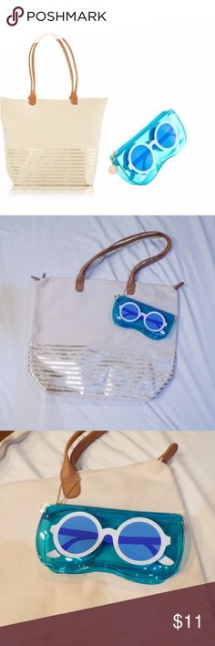 Bath and Body Works Tote Bag Canvas tote beach bag. Gold stripes along bottom. Detachable plastic see-through blue zipper pouch with white sunglasses. Gold colored Bath & Body Works charm on zipper pouch. Tan handles. Perfect for the beach, pool, or everyday. Smoke Free + Pet Friendly Home. Bath and Body Works Bags Totes