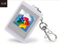 Features:  .Brand new 1.5 inch LCD Mini Digital Photo Frame with Keychain and Built-in 16M Memory  .