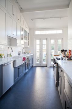 Shaker cabinets, dark wood, marble countertops, subway tile, stainless steel