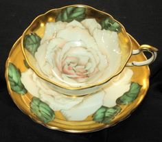 Paragon England white pale peach pink tea rose, gold wide tea cup and saucer.