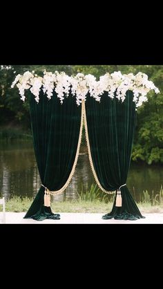 Gorgeous velvet draping with flowers as a wedding ceremony backdrop