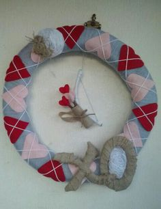 DIY Valentine's Wreath! Made from scratch using...yarn, felt, burlap, twigs and foam pipe covers.
